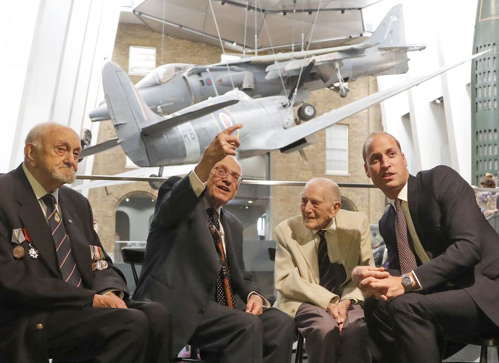 The Duke of Cambridge (right) meets Freddie Knoller (second left), as well as two veterans of World War II, Ted Cordery (left) and John Harrison during a visit to the Imperial War Museum in London.  Photo credit: Frank Augstein/PA Wire