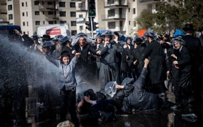 Ultra-Orthodox Jewish clash with Israeli police during a protest against the arrest of rabbi Shmuel Ya'akov Kahn grandson who failed to comply with a recruitment order, near the army recruiting office in Jerusalem  Photo by: JINIPIX