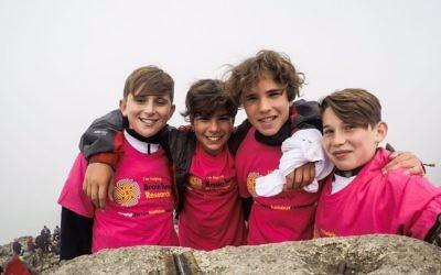 Jonah, Malakai, Abe and Ben at the summit of Ben Nevis