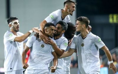 Nick Blackman (second from left) is congratulated by his teammates after scoring in Monday night's win against Maccabi Netanya. Picture: MTA