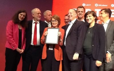 Labour leader Jeremy Corbyn (second left) presenting an award to JLM. Louise Ellman (centre) is holding the award, while former chair of the movement, Jeremy Newmark is on her right.  (Photo Credit: @JewishLabour on Twitter)