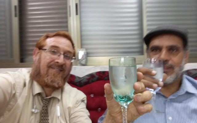 Likud Party MK Yehuda Glick with Muhammad Sabir Jabir in his Hebron  home
