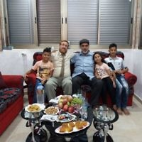 Likud Party MK Yehuda Glick with Muhammad Sabir Jabir and his family in his Hebron  home