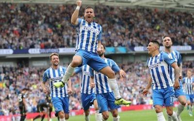 Tomer Hemed celebrates his match-winner against Newcastle