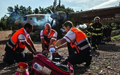 Israeli rescuers train for an emergency using realistic looking fake limbs,