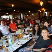 Let's Talk Business group at a restaurant in the West Bank