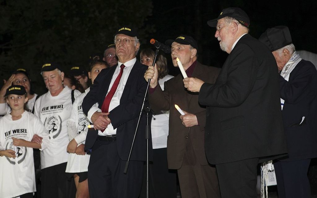 Young and old remember Elie Wiesel at the Holocaust memorial in Sighet