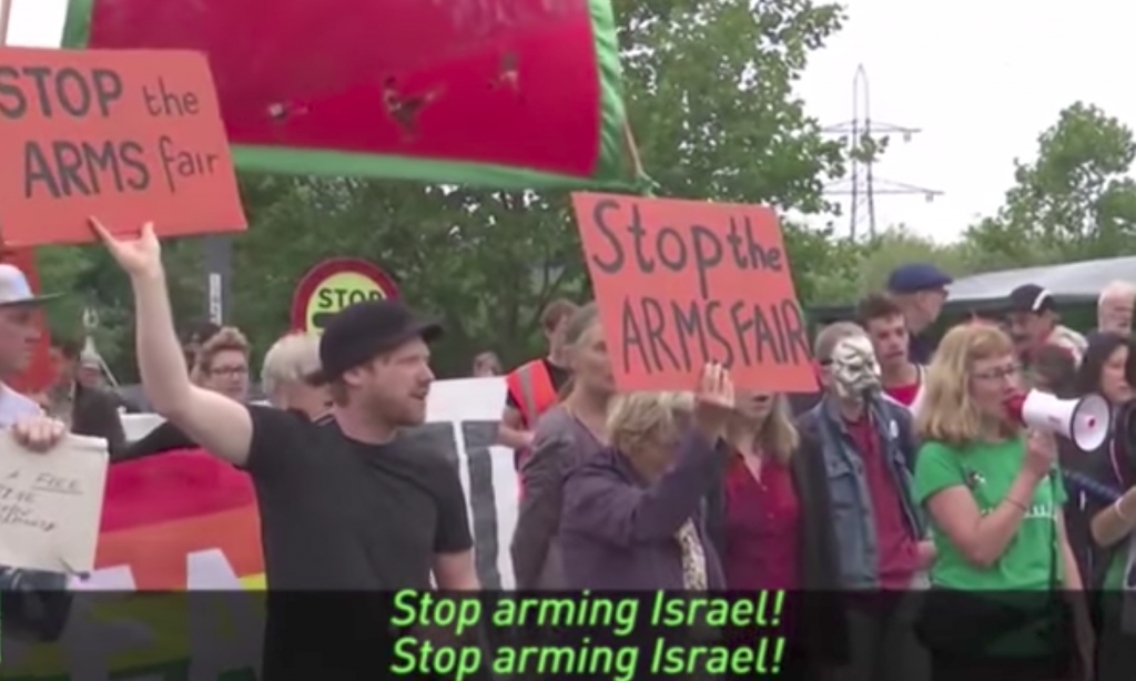 Protesters shouted 'stop arming Israel' and waved banners