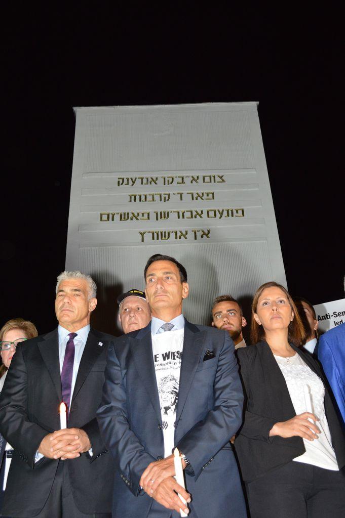 Israeli Parliamentarian Yair Lapid; chair of Limmud FSU International Steering Committee, Matthew Bronfman, and Israeli Minister for Social Equality, Gila Gamliel, at the Holocaust memorial in Sighet
