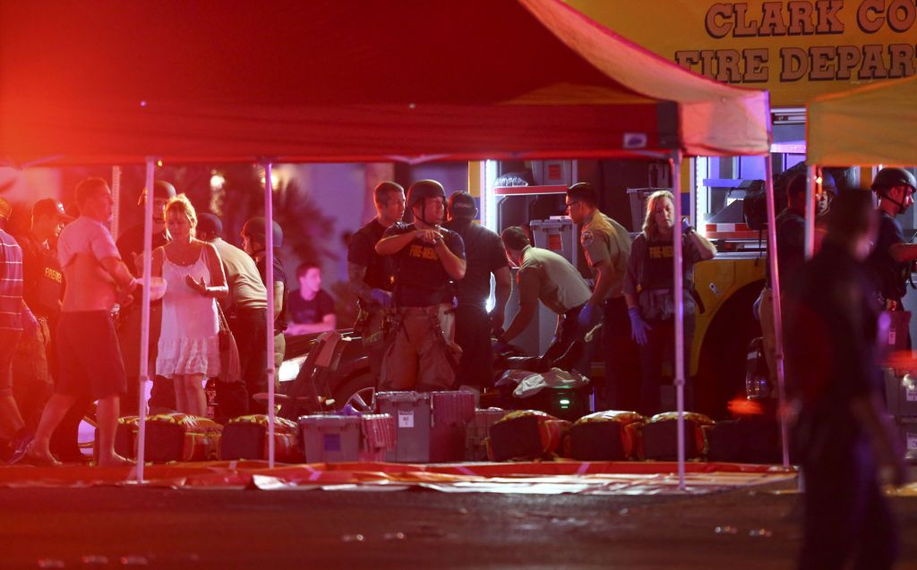 Medics treat the wounded as Las Vegas police respond during an active shooter situation on the Las Vegas Stirp in Las Vegas (Chase Stevens/Las Vegas Review-Journal via AP)