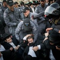 Ultra Orthodox Jewish men being arrested by Israeli police as they block a road during a protest in Jerusalem, Israel, 19 October 2017.     Photo by: JINIPIX