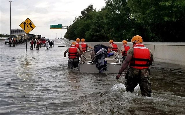 Soldiers with the Texas Army National Guard move through flooded Houston streets to combat rising floodwaters from Hurricane Harvey