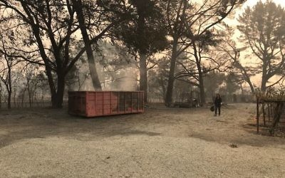 The scene at Hagafen Cellars after wildfires raging in Northern California burned land, vegetation and equipment, Oct. 10, 2017.   (Picture credit: Hagafen Cellars on Facebook)