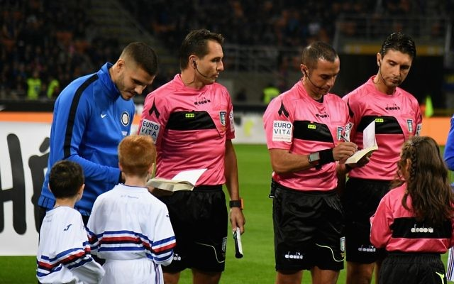 Inter Milan captain Mauro Icardi signs a copy of Anne Frank's diary for a mascot ahead of their side's game against Sampdoria