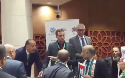 Moroccan politicians with Palestinian scarves verbally attack Amir Peretz, an Israeli former Defence minister, during a visit in Rabat. An Israeli Druze lawmaker came to Peretz's Defence in Arabic.