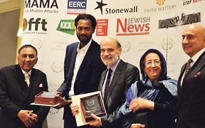 Imam Bocoum and Rabbi Wittenberg receiving their award at 2017 #no2h8crime awards