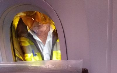 An engineer examines the cracked window on board the El Al Dreamliner flight Picture Credit: Jewish News