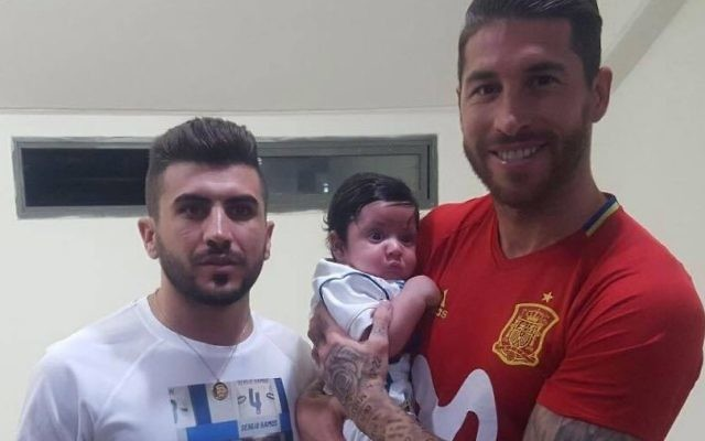 Sergio Ramos, pictured holding Ramos and with the brother of murdered police officer Haiel Sitawe