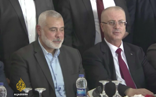 Hamas leader Ismail Haniyeh  (left) with Rami Hamdallah (right) during a cabinet meeting in Gaza   Source: Screenshot from Al Jazeera video