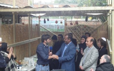 Rabbi Levy and Abdurahman Sayed addressed attendees at the Al Manaar Mosque's succah