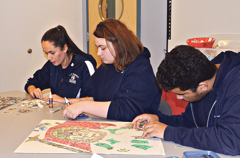 Students creating one of the artworks