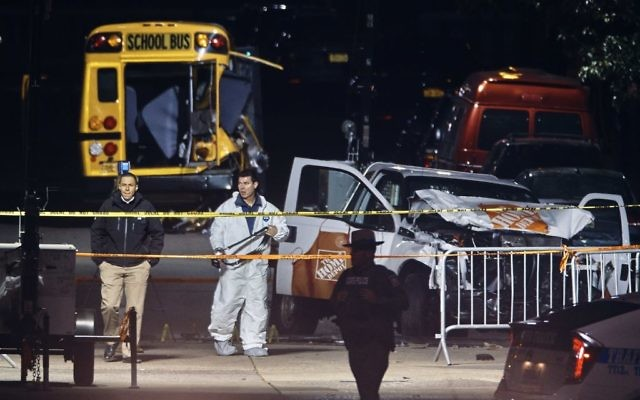 Police work near a damaged Home Depot truck after a motorist drove onto a bike path near the World Trade Centre memorial, striking and killing several people   (AP Photo/Andres Kudacki)