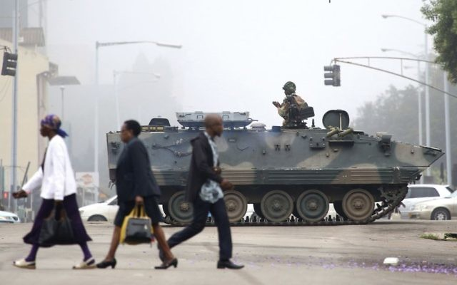 An armed soldier patrols a street in Harare, Zimbabwe   (AP Photo)
