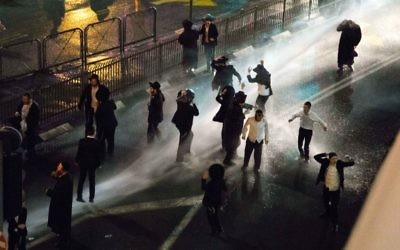 Charedi Jews being targeted with water cannons in Jerusalem during a protest in November 2017