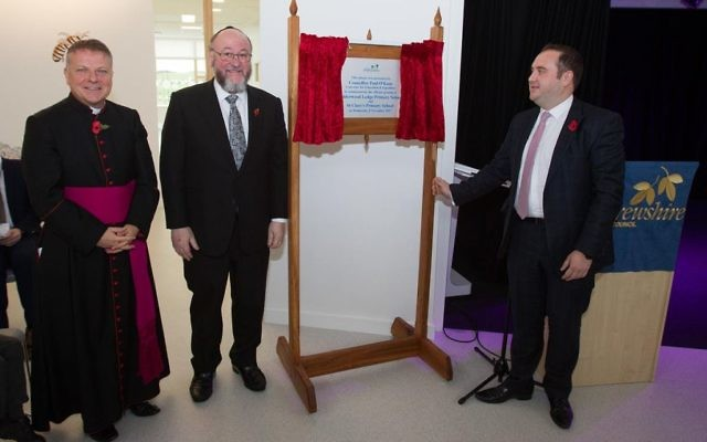 Chief Rabbi Ephraim Mirvis and Bishop John Keenan (left) unveil a plaque opening the school