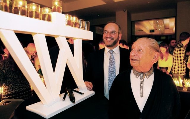 Solly Irving at a Chanukah candle-lighting ceremony with JRoots Executive Director and long-standing friend Rabbi Naftali Schiff