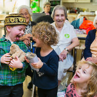 Fun as Apples and Honey Nursery visit Nightingale House care home in Clapham - picture by Yakir Zur