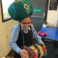 A student at  Keser Torah in Gateshead with a drum instrument