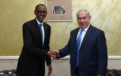 Rwandan President Paul Kagame (left) greets Israeli PM Benjamin Netanyahu