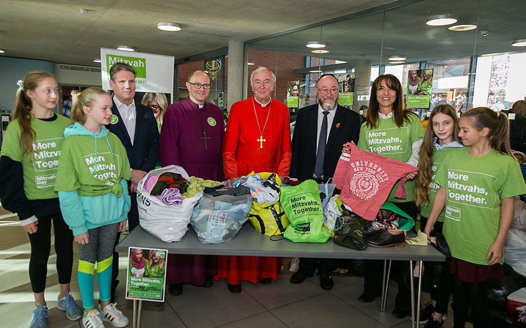 Keir Starmer, Bishop of Edmonton, Cardinal Nichols, Daniela Pears and South Hampstead school children sorting clothes for the homeless - picture by Yakir Zur