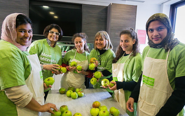 Mitzvah Day founder Laura Marks and a joint Jewish and Muslim group cook for the homeless at JW3 - Picture by Yakir Zur