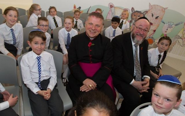 Bishop John Keenan (left) and Chief Rabbi Ephraim Mirvis (right) talk to students at the new school