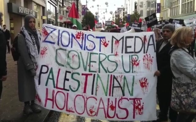 Protestors with their anti-Israel banners at the central London march. Picture: CAA