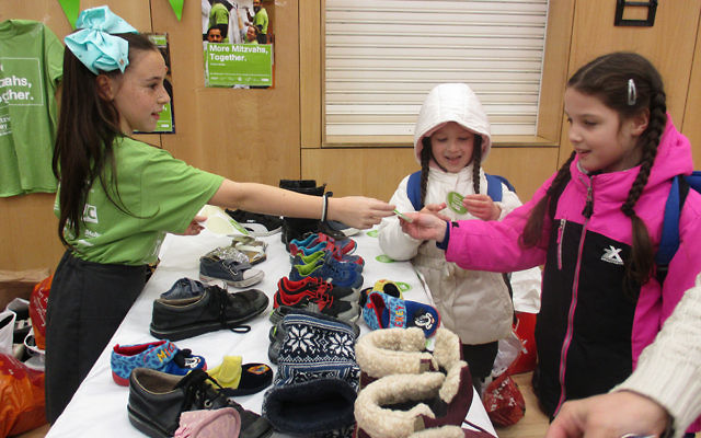 Pupils at Wohl Ilford Jewish Primary School collected plastic bottle tops for Lupus UK, footwear for Unicef and toys for Camp Simcha