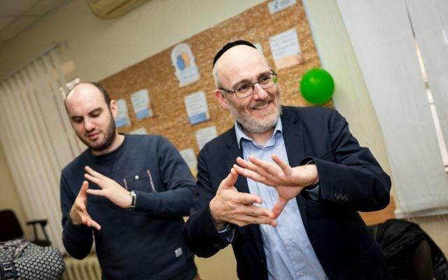 Rabbi Belovski and World Jewish Relief staff member Sam Schryer take part in activities at the Jewish Community Centre in Zaporizhia, Ukraine.