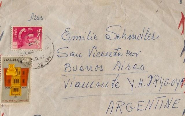 Emile Schindler's German passport and letter with Israeli stamps are among the archive.