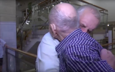 Eliahu Pietruszka embraces 66-year-old Alexandre, a nephew he never knew he had, who flew from Russia to see him.
