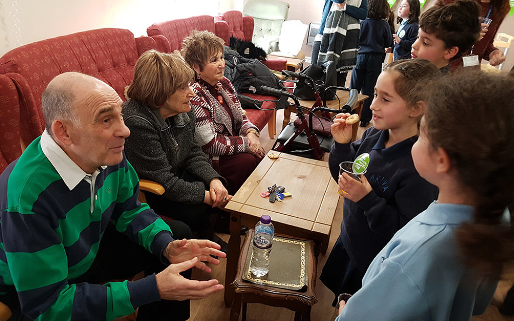 The Akiva School choir entertained tenants at Jewish Blind & Disabled's Fairacres building in East Finchley, then helped serve refreshments