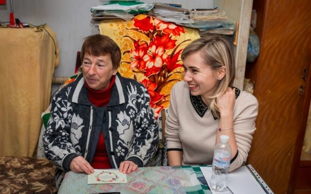 Valentina (L) receives support from World Jewish Relief and sits alongside World Jewish Relief staff member Katya Roshchyna (R) during a visit to her home
