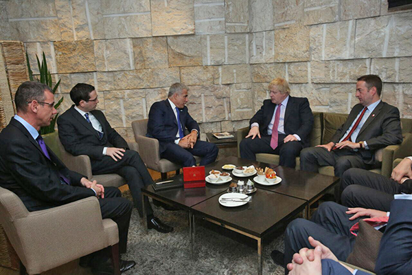 Yair Zivan (second from the left) with Boris Johnson and Yair Lapid