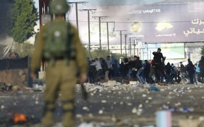 Palestinians clash with Israeli troops during a protest l in the West Bank City of Nablus,, Dec. 2017. (AP Photo/Majdi Mohammed)