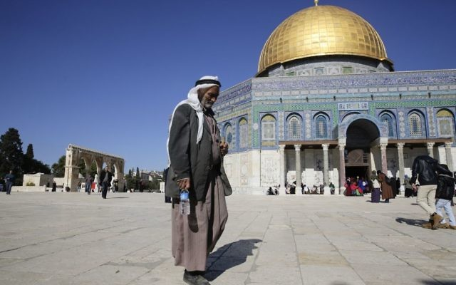 A Palestinian walks in front of the Dome of the Rock ahead of the prayers in Jerusalem, Friday, Dec. 8, 2017.  (AP Photo/Mahmoud Illean)