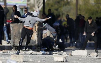 Palestinians clash with Israeli troopsl in the West Bank City   Dec. 8, 2017.   (AP Photo/Majdi Mohammed)
