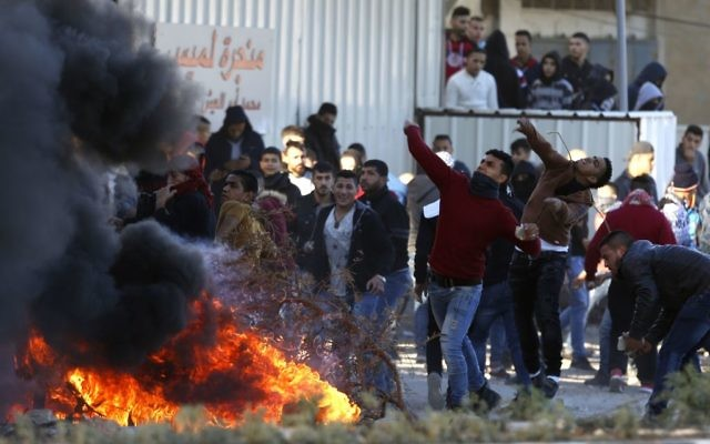 Palestinians clash with Israeli troops following a protest in the West Bank City of Nablus,   Dec. 8, 2017. (AP Photo/Majdi Mohammed)
