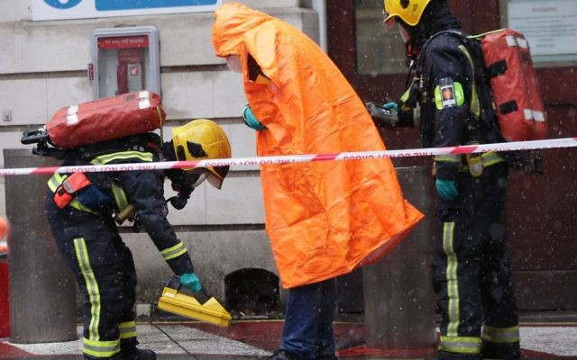 Members of the police, fire brigade and ambulance service during a joint exercise to test their response to a ÔHAZMATÕ type ncident involving a hazardous substance, at the Israeli Embassy in Kensington, London.   Photo credit: Yui Mok/PA Wire