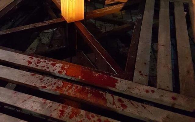 Blood splattered on the base of the menorah in Kiev.   Credit: Reuven Stamov on Facebook